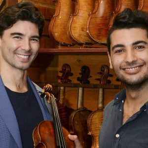 Florain Leonhard Fine Violins sales manager Thomas Wei presents the 1690 'Stephens' Stradivarius violin to Rami