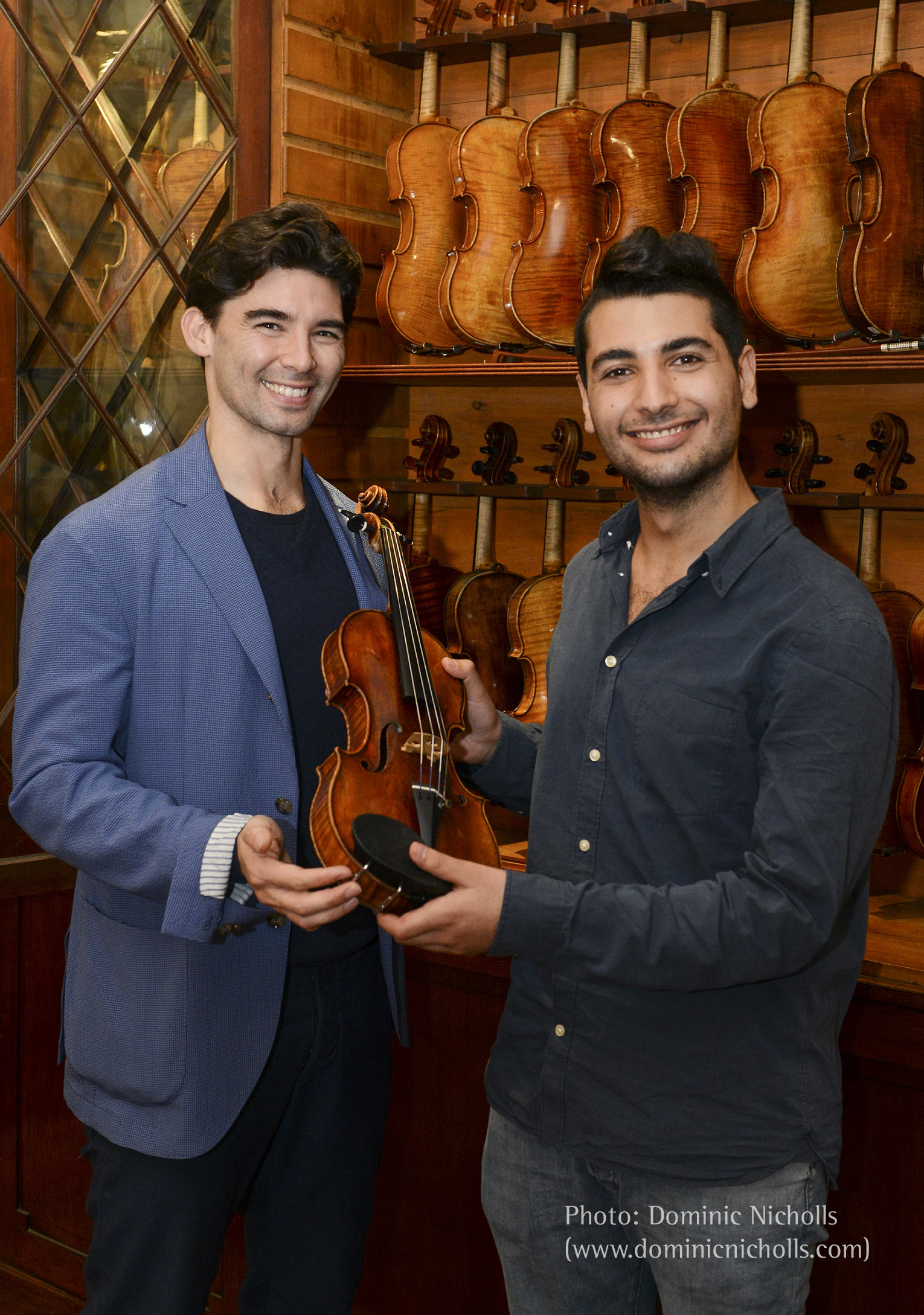 Florian Leonhard Fine Violins sales manager Thomas Wei presents the 1690 'Stephens' Stradivarius violin to Rami